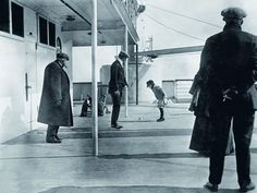 A boy plays aboard the deck of the Titanic.