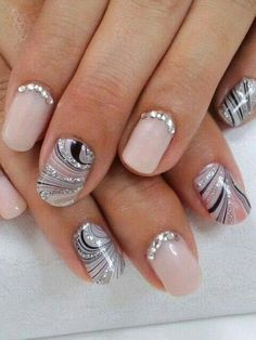 Silver swirl nails.