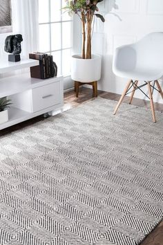 Paddle Rug: Create an urban and chic look with this contemporary hand-woven paddle rug that spells quality as well as durability. Available in subtle colors and delicate pattern in runner and rectangles forms