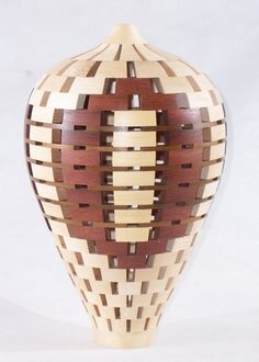 "Colin Delory: An 11"" x 6-3/4"" vessel consisting of 266 individually cut and positioned segments of Maple, Bubinga and Yellow Cedar.  This unique work was assembled and shaped on the lathe."