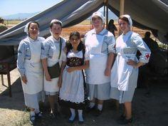 A group of re-enactors dressed as German Red Cross nurses.