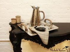 Pretty black table with cute shiny items!