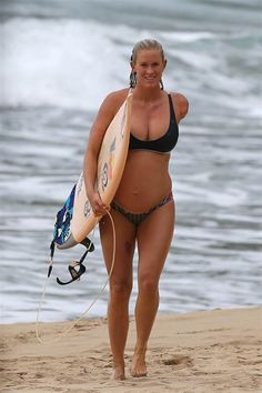 Bethany Hamilton 6 months pregnant and still surfing.