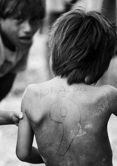 An Indian child from Xavantes has his back painted with the name and jersey number of Brazilian soccer player Ronaldo at Maraiwatsede tribe in Mato Grosso, northwest of Brasilia.