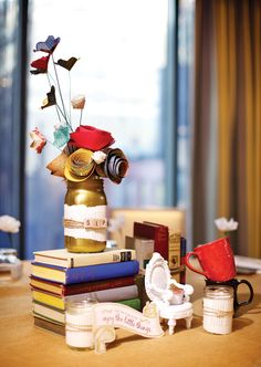 Book Club Party Ideas - themed centerpiece with vintage books & paper flowers