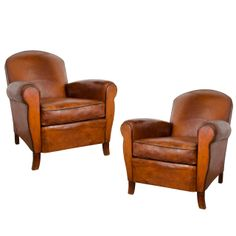 Pair of French Leather Club Chairs | From a unique collection of antique and modern club chairs at http://www.1stdibs.com/furniture/seating/club-chairs/