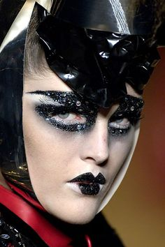 Dior Look #2: Whoa. Bette Davis reincarnated as a goth punk on whatever narcotic…