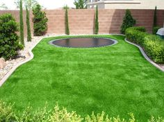 Trampoline surrounded by fake grass. Need this!