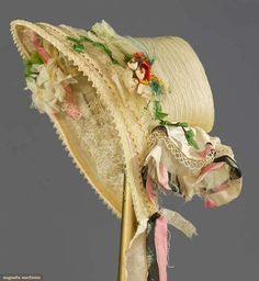 """HORSEHAIR SPOON BONNET, c. 1860 Blond horsehair, narrow braid, original cloth flowers on top & under brim, pink, black & white silk brocade ribbon, (small hole at back crown, tiny hole to brim, bobbin lace under brim matted) Augusta Auctions """