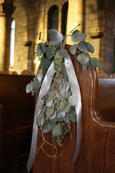 Beautiful for a Winter wedding at the end of pews or chairs. We have glitter on curly willow tips.