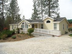 3541 Newtown Rd, Placerville, CA 95667 — PRISTINE TURN-KEY COUNTRY CHARMER on lovely manicured acreage. There was no expense spared in the making of this lovely manufactured home with 2X6 construction and many custom upgrades including granite counters & hardwood flooring.  Three roomy bedrooms with expansive master suite and luxurious master bath. Great room concept with cathedral ceiling, light and roomy.  Detached two car garage.  Home sits high and faces off of Newtown Road for privacy…