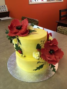 Sugar Heaven cake made for my boss's wife Janice's BDay.  It is lemon buttercream, lemon poppyseed cake with gum paste poppy and sweet pea flowers and buds and some handpainting on the cake as well.
