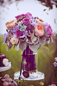 bouquet with purple, taupe, & pinks, with costume jewelry