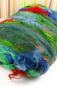 "Jazzturtle on Etsy. ""Amazon Parrot"" textured drum-carded batt of angelina, alpaca locks, coopworth locks, cormo fleece, firestar, lurex, merino fleece, merino top, kid mohair locks, mulberry silk, sari silk threads, targhee fleece, teeswater locks, wensleydale locks."