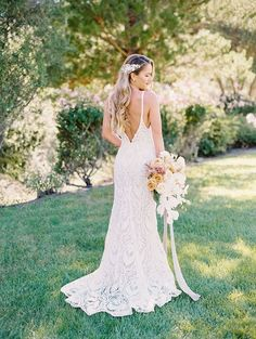 Low Back Wedding Dress in Bohemian Lace with a Cascade Bouquet