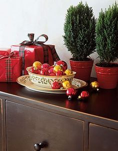Display red & gold ornaments in a simple Christmas serving dish.