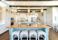 beach house kitchen with two islands