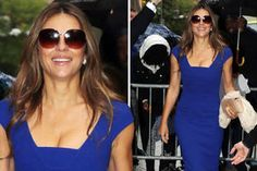 Elizabeth Hurley flashes cleavage showcases sensational curves blue gown