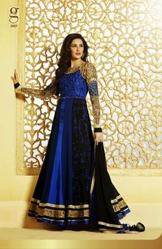 Enticing Nargis Fakhri in Deep Blue and Gold anarkali suit with chiffon dupatta, it has velvet yoke with heavy embroidery of gold on it, and also backside, pair with the full sleeves with the middle strip through yoke, the whole work is based on zari work, kundans, beads, having a layer embroidery bottom.