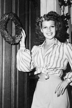 Rita Hayworth at home on Christmas Eve, 1942