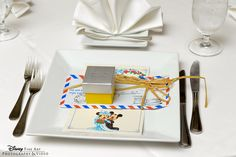 This travel-inspired place setting is perfect for the jet-setting couple #Disney #wedding #reception #decor