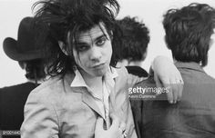 Australian singer and songwriter Nick Cave with members of The Birthday Party at the Hacienda, Manchester, 24th February 1983. Credit: Kevin Cummins