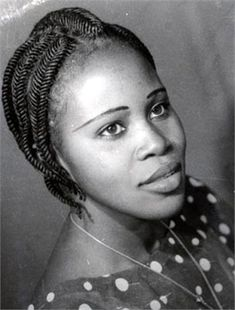 1959 photo of a Nigerian Woman with her Hair Threaded, this hairstyle is called Goat.