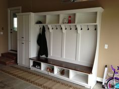 Our new mudroom in the garage!  I designed it, had a friend build it for me & I painted it.  Favorite room in the house!
