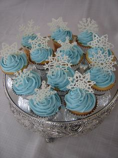 """Snowflake cupcakes - I was inspired by mawagner's cupcakes.  I piped the snowflakes with candy melts and stuck them into the buttercream.  I was surprised I didnt have more breakage, but they really were fast and easy.  I found the snowflake template on this site.  Thanks for looking!"" simple, pretty winter cupcakes"