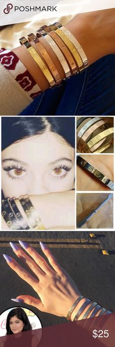⚜️ • TWO kylie bracelets : GOLD These look exactly like the love bracelet cuffs that Kylie Jenner is never seen without! Two regular gold; one is studded with screws and has little diamonds between each screw; the other is gold with screws. This is for a set of TWO gold bracelets. Jewelry Bracelets