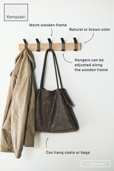 Offering a modern, urban feel, this wall-mounted coat hanger features adjustable metal hangers that glide along the wooden frame allowing for maximum flexibility. Comes with 5 hangers. Use as many as needed. Please note that some variation in the natural wood tone and grain is expected.