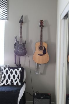 I have my husband classical guitars hanged, but this rocks!, and his electric guitar is painted in my favorite color