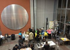 The scene at Book Arts Night at MAH. Wax Works is demonstrating palette collage and encaustic monoprinting.