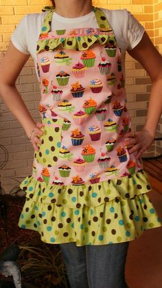 Apron features sweet little multi-color cupcakes, polka dots, ruffles, and Ric Rac trim.