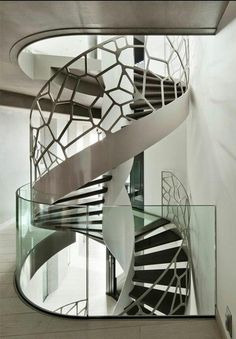 Helical stairs or curved staircase is a graceful form in architecture with it's flowing helix and absent centre column. Check our helical staircase photogallery Modern Architecture House, Architecture Details, Interior Architecture, Staircase Architecture, Installation Architecture, Balustrades, Glass Balustrade, Escalier Design, Interior Stairs