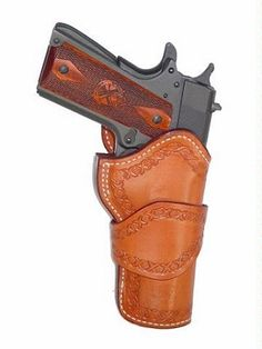 Wild Bunch 1911 Holster-For that competitive edge, the Wild Bunch 1911 holster has a classic western look for your 1911 semi-automatic. The holster fe 1911 Holster, Pistol Holster, 1911 Pistol, Colt 1911, Custom Leather Holsters, Pink Guns, Western Holsters, Cowboy Action Shooting, Lever Action Rifles