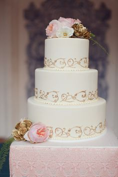 cream cake with gold detailing // photo by Brandon Kidd // cake by Sweet Gems