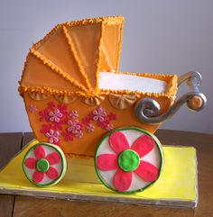 This is such a cute cake for a baby shower! #BabyCarriageCake #babyshower #cake #carriage