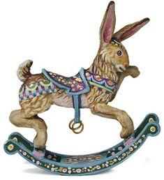 *RABBIT ~ cast in metal on wooden runners. Molded saddle + brass stirrups.   Amanda E. Skinner – Miniatures