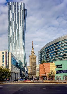 """The """"Sail"""" - Warsaw, Złota 44 Office Building designed by architect Daniel Libeskind. The Palace of Culture and Science in the background."""