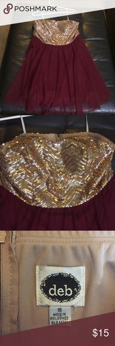 Size 16 gold sequin and maroon tulle formal dress This dress was only worn a few times in great condition very pretty maroon color all the gold sequins on the top are intact it's a size 16 from Deb Deb Dresses Strapless