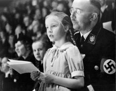 Heinrich Himmler and his daughter, Gudrun in 1941. Gudrun, who lives in Munich, is to this day an unapologetic Nazi. Since 1951, she has been an active member of Stille Hilfe, an organization supporting arrested, condemned or fugitive former SS members. However, Katrin Himmler, Heinrich's great niece, regards him as a mass murderer. Despite her name, she married a Jewish survivor of the Warsaw Ghetto, and lives with him in Israel. What a disgrace to humanity