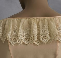 """Edwardian style vintage blouse, 1970s. Finely fashioned from peach colored silk crepe de chine with French seams and rows of pin tucks, the princess line seams give the blouse a figure flattering shape (4"""" longer in back). The hem border is of expensive handmade Cluny lace, a Victorian handmade bobbin lace, which is worked in linen thread and has braided bars and small petal-shaped wheat ears."""