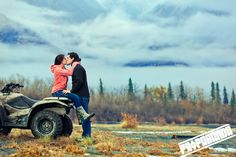 Alaska Engagement Session: Chelsie & Vincent Lovestory. Engaged couple kissing on four wheeler in Alaska - Propaganda AK
