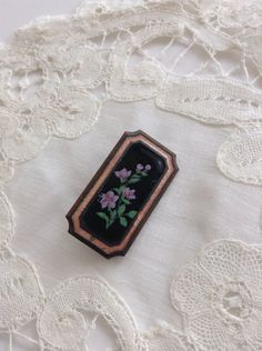 I believe she was originally a piece of mourning jewelry as the black enamel has a lily floral spray.and she's set on a darker copper/bronze and it appears that her pin back has been replaced. Mourning Jewelry, Black Enamel, Brooch Pin, Copper, Lily, Bronze, Antiques, Floral, Brooch