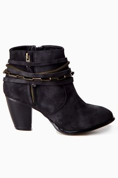 Add a bit of edgy flair to your fall ensemble with this season's go-to ankle boot.