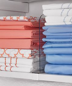 Think outside the norm. Linen closet organized with clear plastic dividers via Real Simple