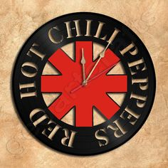 This would be great for the man-cave. The artist has several other choices of other popular singers and bands.  Wall Clock Red Hot Chili Peppers Vinyl Record by geoartcrafts, €25.00