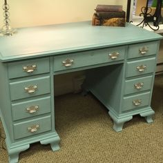 "This beautiful turquoise toned desk was painted with chalk paint and offers nine drawers and a sleek look to add to any room in your house or office. Measurements: 29 1/2""Hx46 1/2Lx25 1/2""W"