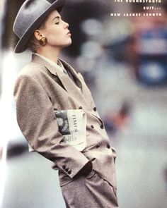 Peter Lindbergh photograph for a London collections fashion editorial in the August 1986 issue of British Vogue. Jeny Howorth wears a Margaret Howell suit and shirt with a grey felt hat by Stephen Jones. Hair by Sam Mcknight and makeup by Stephane Marais.